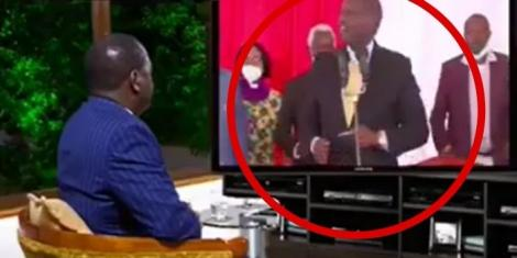 The edited clip to show Raila Odinga watching DP William Ruto singing. According to a video expert, the TV is badly positioned and is not in line with the room's perspective.