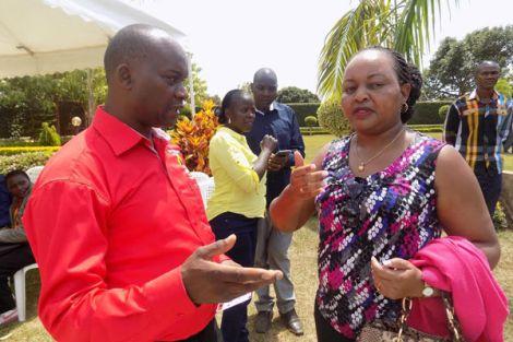 Kirinyaga Governor Anne Waiguru (right) speaks to her deputy Peter Ndambiri.