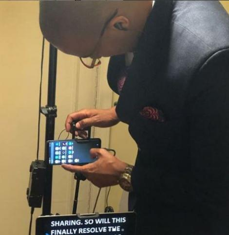 Citizen TV anchor Waihiga Mwaura setting up his phone for the bulletin on July 28, 2020.