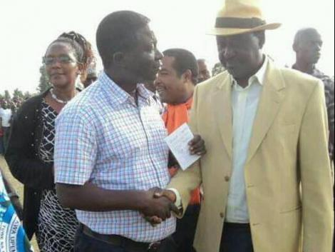 Kasipul MP Charles Were (left) with ODM leader Raila Odinga during a political function in September 2016.
