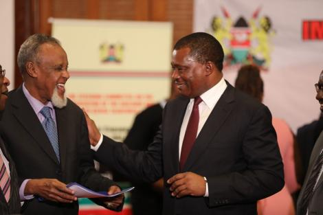 National Assembly Speaker Justin Muturi (right) presents a report to Building Bridges Initiatives (BBI) Taskforce Chairperson Senator Yusuf Haji on Tuesday, March 10, 2020.