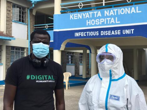Digital Humanitarian founder Philip Ogola with a front line health worker at Mbagathi isolation centre on May 28, 2020.