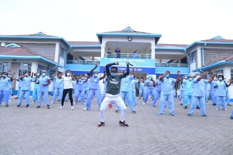 A dance instructor takes the health workers at Mbagathi isolation centre through a dance routine on May 28, 2020.