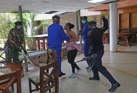 Police officers clobber Mlango Kubwa MCA Patricia Mutheu at City Hall on Tuesday, July 28.