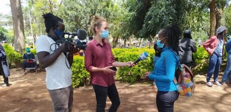 DW journalist Mariel Muller conducting an interview during protests in Nairobi on Saturday, May 1