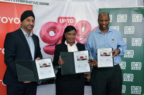 (L-R) Toyota Kenya Managing Director Arvinder S. Reel, Co-op Bank Ag Director Corporate & Institutional Banking Jacqueline Waithaka and Co-op Bank Fleet Africa Leasing Managing Director Robert Mbugua display the deal documents following the sign-off the joint financing deal that will offer up to 95% financing for the purchase of Toyota vehicles.