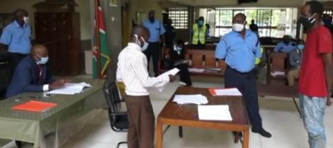 The suspect (in red) appearing before a judge at the Mombasa Law Courts on Wednesday, May 27, 2020