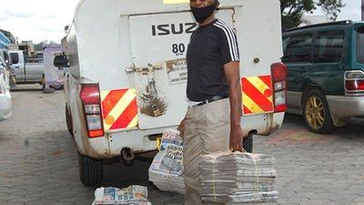 NMG staff packing newspapers into a delivery vehicle