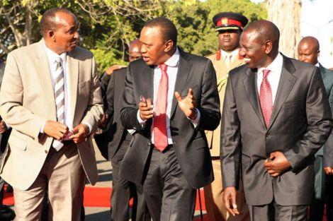President Uhuru Kenyatta (centre) with Deputy President William Ruto (right) and Majority Leader Aden Duale at Jomo Kenyatta International Airport on January 29, 2014.