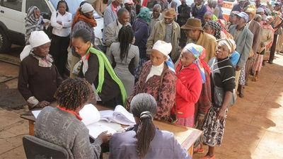 The elderly queuing for cash payments under the social protection programme.
