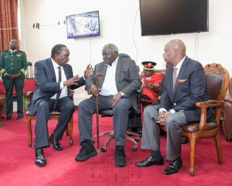 Retired President Mwai Kibaki condoles with Rongai MP, Raymond Moi (left) and his younger brother Gideon Moi (Baringo Senator) after viewing the body of his predecessor the late Daniel Arap Moi at Parliament buildings on February 9, 2020