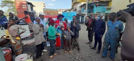 Dr Hassan Omari celebrating his graduation with street children.