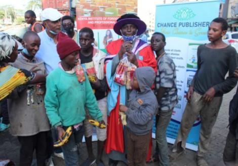 Dr Hassan Omari celebrating his graduation with street children in December 2020.