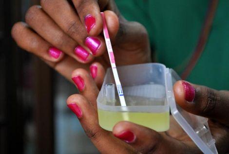 A woman conducting a pregnancy test