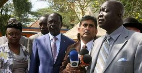 A photo of former Gem MP Jakoyo Midiwo (right) with Raila Odinga with other ODM leaders at a past event.