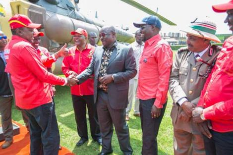 President Uhuru Kenyatta with former Bomet Governor Isaac Ruto before a Jubilee rally in Kericho on September 8, 2017
