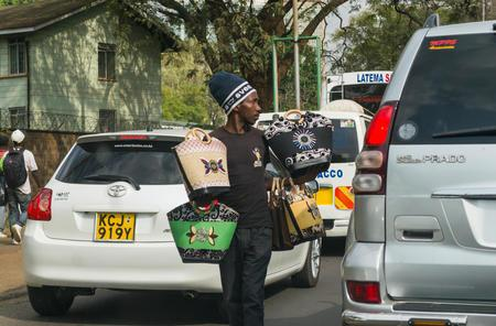 A hawker selling handbags to motorists stuck in traffic on Uhuru Highway in Nairobi
