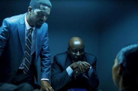 John Sibi Okumu (seated) playing the role of Barasa in the Showmax Original Show Crime and Justice