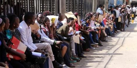 Youth queue outside County Hall, Nairobi with their certificates.