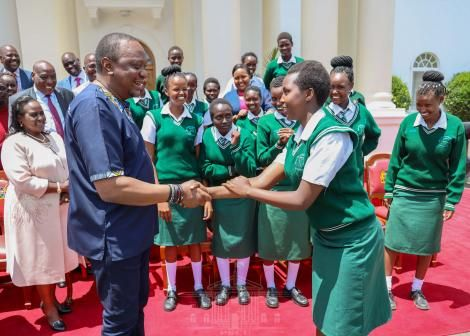 President Uhuru Kenyatta interacts with students of Nyiro Girls' Secondary School, Samburu County at State House, Nairobi after donating a bus to the school on Friday, November 1, 2019.