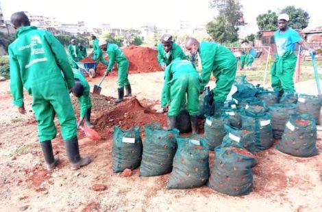 Members of Komb Green Solutions setting up an urban garden in Korogocho slums
