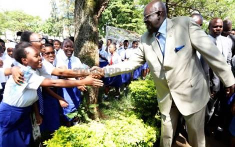 CS George Magoha shaking hands with candidates of Kisumu Girls High School on November 5, 2019.