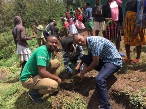 Miti Alliance founder and CEO Michael Waiyaki (left) during a tree planting activity in May 2019.