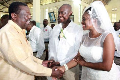 Musalia Mudavadi (left) shares a light moment with his ANC Chairman Kelvin Lunani (centre) and wife Sarah Otieno during Lunani's wedding ceremony in Mombasa on December 15, 2018