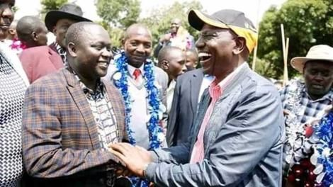 Dennis Kapchok (left) with DP William Ruto (right)