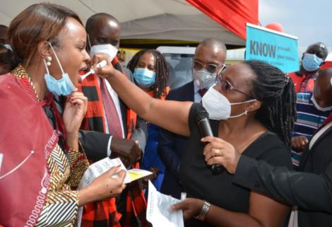 DR Mercy Mwangangi (left) using the self test HIV on December 2, 2020.