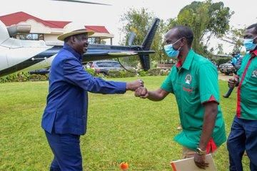 ODM leader Raila Odinga and MP named Wilson Sossion at a party in Bomet on Saturday, September 19.