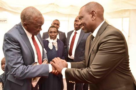 Deputy President William Ruto and the late Kenei's father Mzee John Chesang during the deceaased's burial on Saturday, March 7