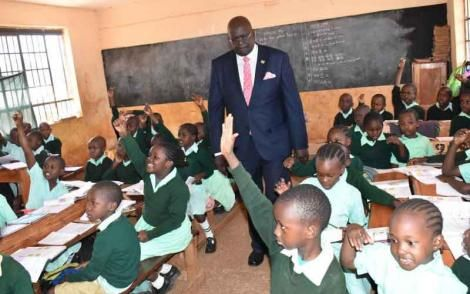 Education CS George Magoha visiting a school in 2019.