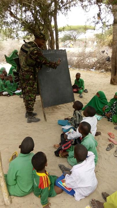 A military officer taking students through their lessons.