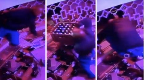 CCTV footage captured the police officer stealing crates of alcohol on March 7