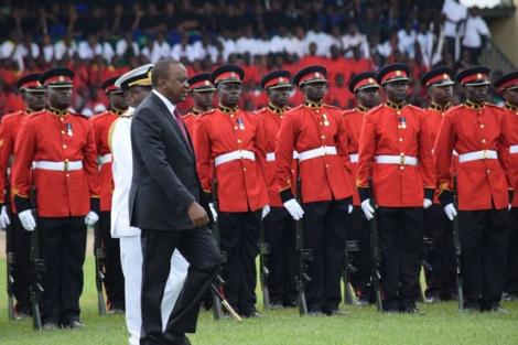 President Kenyatta inspects a guard of honour on arrival at Kinoru stadium in Meru on June 1, 2018.