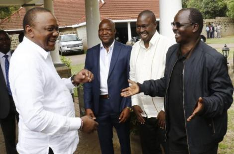 Governor Lonyangapuo (in black Jacket) shares a light moment with President Uhuru Kenyatta in 2019.