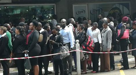 Hundreds of young people line up during an open employment campaign at a city hotel on Saturday May 26, 2018
