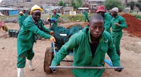 Members of Komb Green solutions setting up their urban garden in Korogocho slums