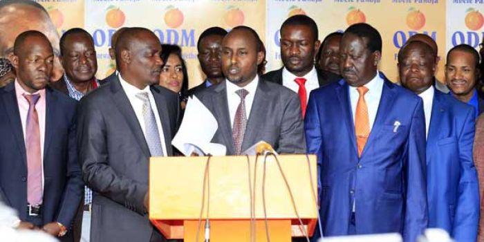 Minority Whip in the National Assembly Junet Mohammed (centre) ODM leader Rails Odinga (right) and Leadder of the Minority in the National Assembly John Mbadi address the press jpg?itok=2CoOlxzJ.