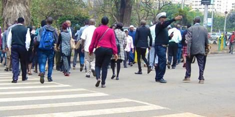 Stock image of Kenyans crossing a street in Nairobi.