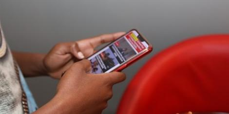 A user browsing through a smartphone for news.