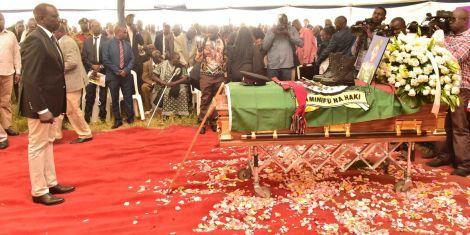 Deputy President William Ruto views Sergeant Kipyegon Kenei's Casket during his burial ceremony in Nakuru on Saturday, March 7, 2020.