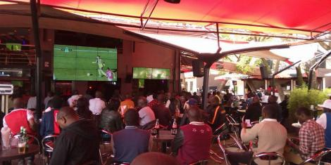 File image of Keyans watching a football match at a bar in Nairobi