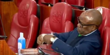 Former Attorney General Githu Muigai checking his face mask during questioning at the Senate on July 22, 2020.