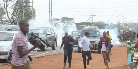Former Kakamega Senator Boni Khalwale (in black cap) runs from Anti-Riot police officers who stormed a parallel meeting during a rally in Mumias on January 18, 2020.