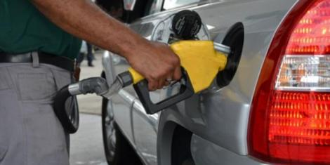 File image of a fuel attendant at work at a petrol station.