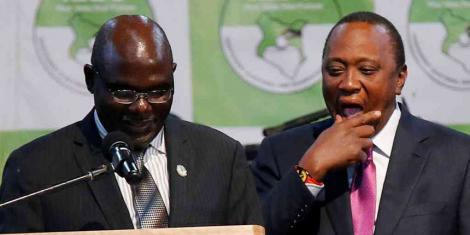 IEBC chairman Wafula Chebukati and President Uhuru Kenyatta at the IEBC National Tallying Centre at the Bomas of Kenya, Nairobi, August 11, 2017, when Uhuru was announced winner of the presidential election.jpg