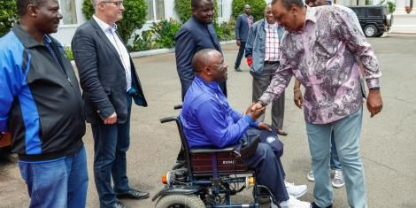 President Uhuru Kenyatta shakes hands with Westlands MP Tim Wanyonyi at State House Grounds on March 7, 2020.