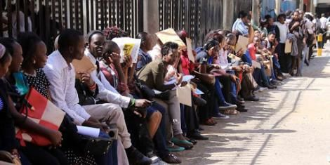 Jobseekers wait to hand in their documents during recruitment at County Hall in Nairobi, 2019.